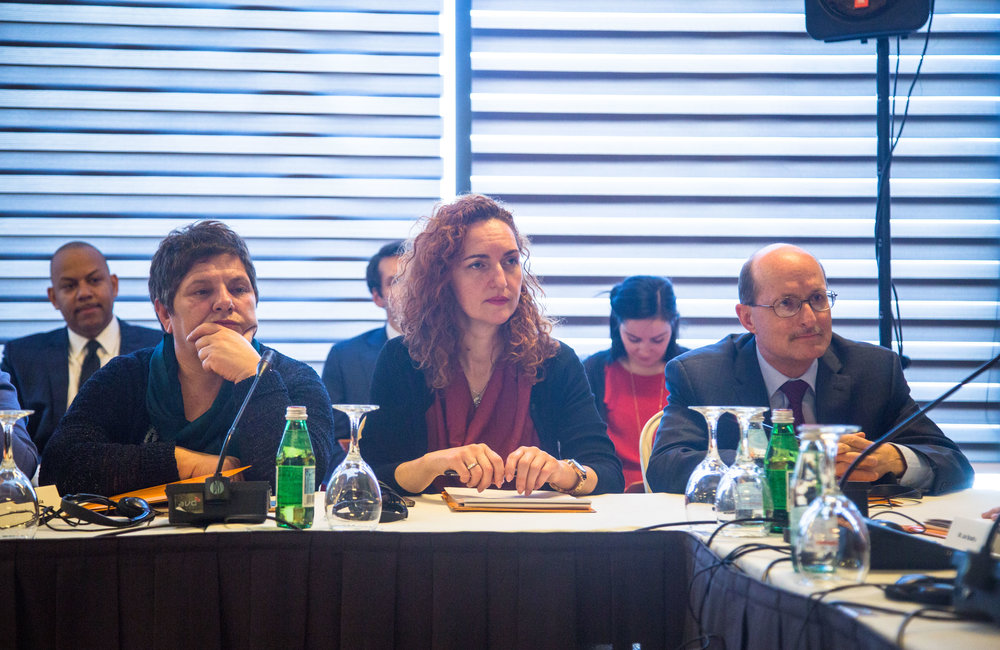 UN Women Kosovo Head Flora Macula (left), UNDP Coordination Specialist Nora Sahatcui, and DSRSG Christopher Coleman.