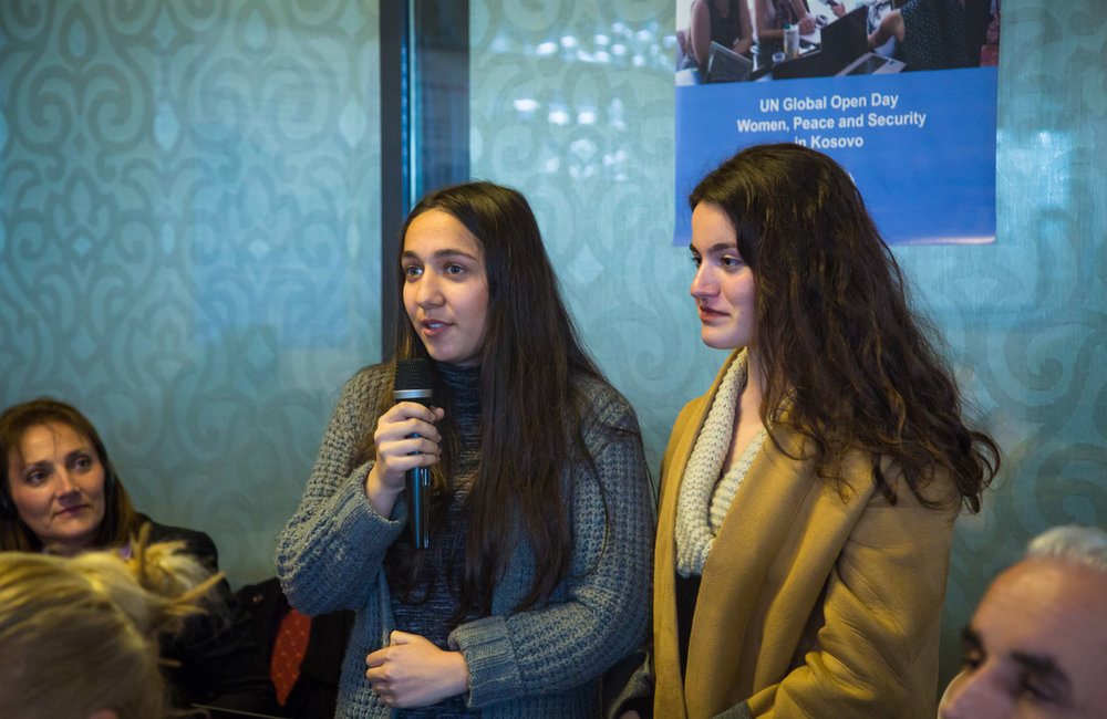 Young members of an activist group from Gjakova called Made with Love, discussing the project where they sell cakes and sweets made by women from a gender-based violence shelter.